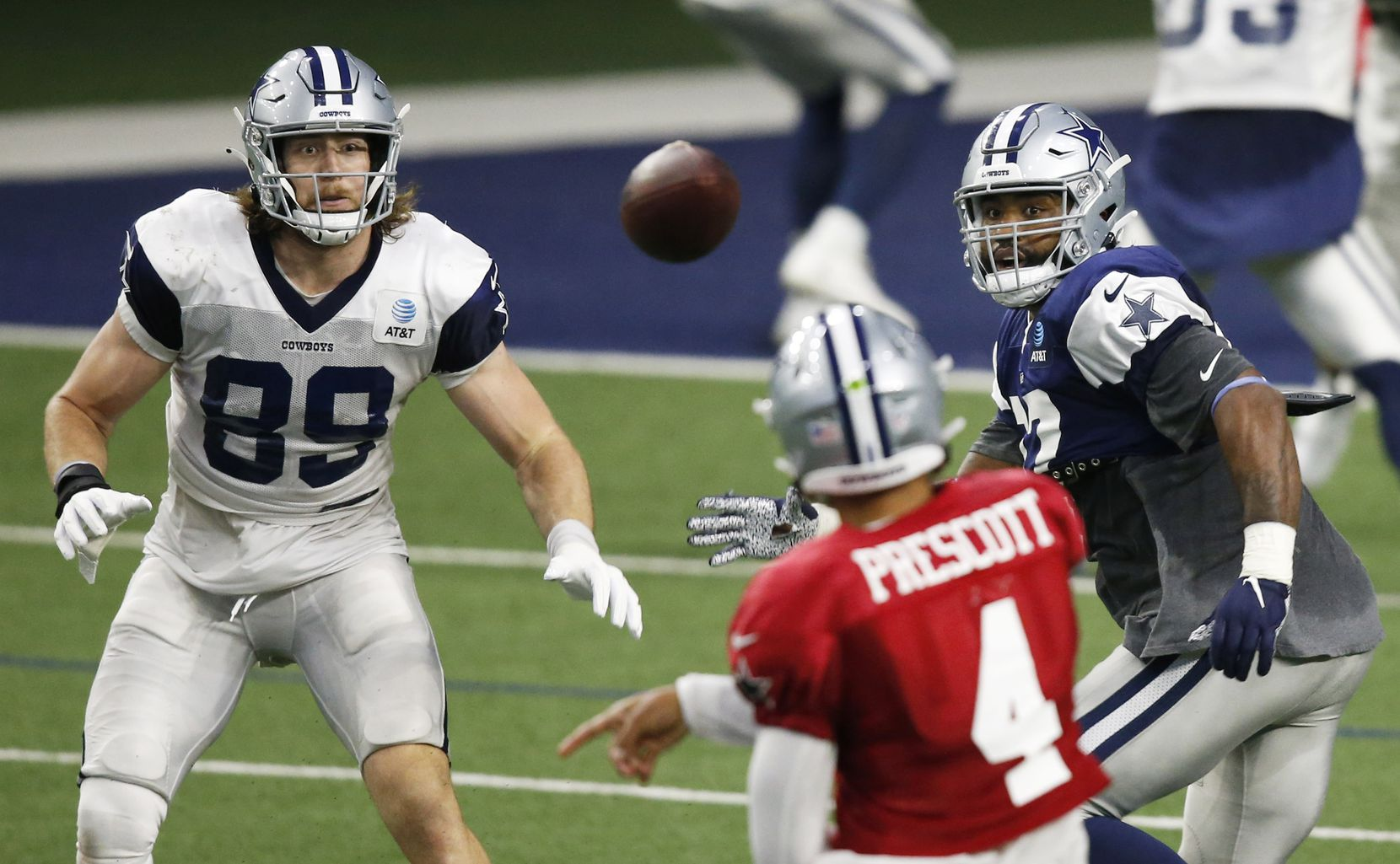 Dallas Cowboys tight end Blake Jarwin (89) and Dallas Cowboys defensive end Everson Griffen (97) watch as Dallas Cowboys quarterback Dak Prescott (4) passes the ball during training camp at the Dallas Cowboys headquarters at The Star in Frisco, Texas on Monday, August 24, 2020. (Vernon Bryant/The Dallas Morning News)