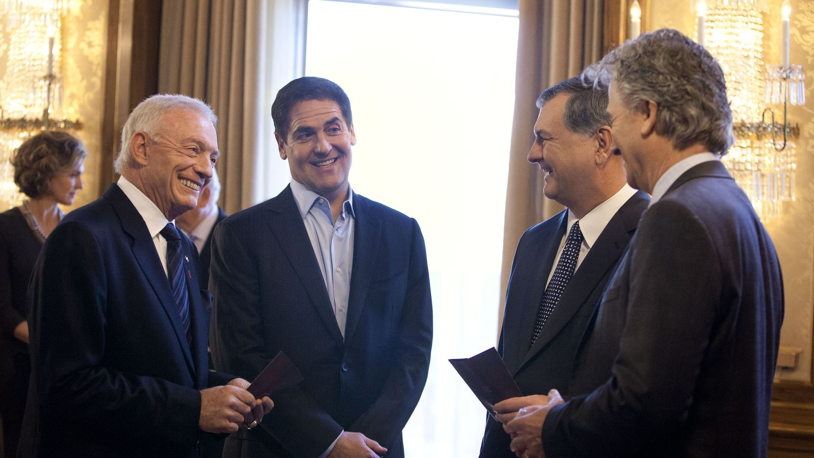 Jerry Jones, Mark Cuban, Mayor Mike Rawlings and Bobby Ewing say their adioses to J.R. on an episode of Dallas. (Skip Bolen/TNT)