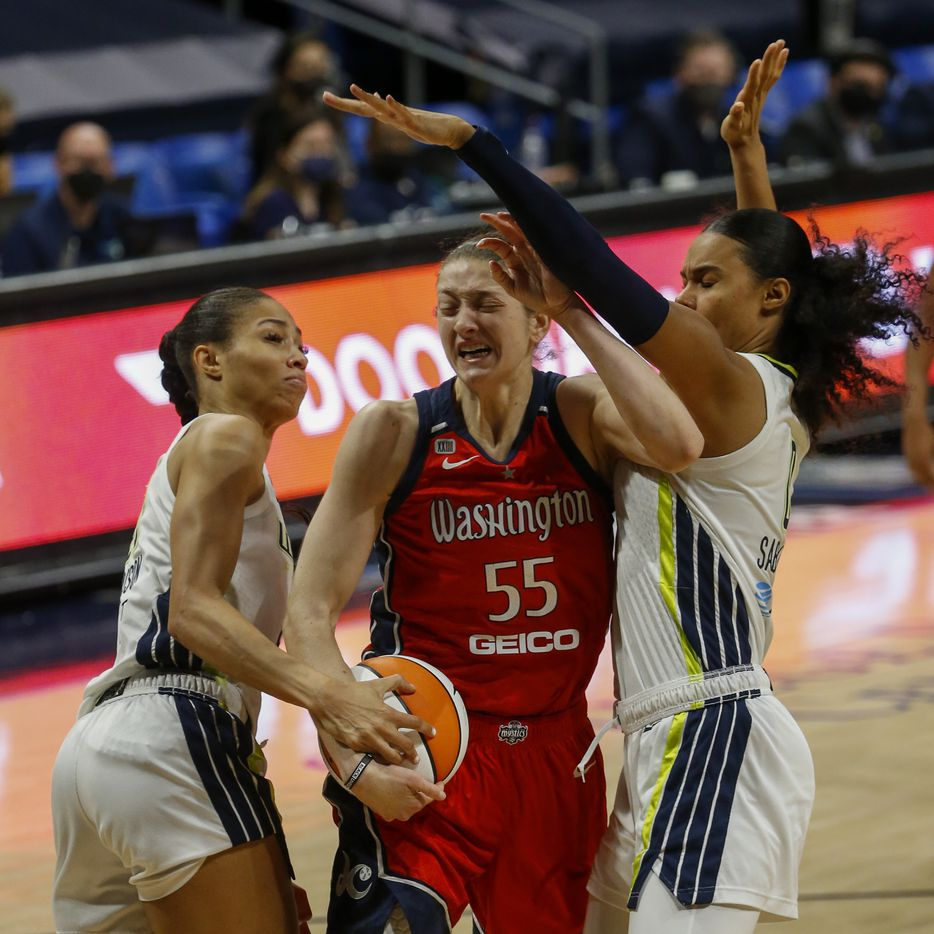 Dallas Wings forward Satou Sabally (0) and forward Isabelle Harrison (20) defend against Washington Mystics forward Theresa Plaisance (55) during the second quarter at College Park Center on Saturday, June 26, 2021, in Arlington. (Elias Valverde II/The Dallas Morning News)
