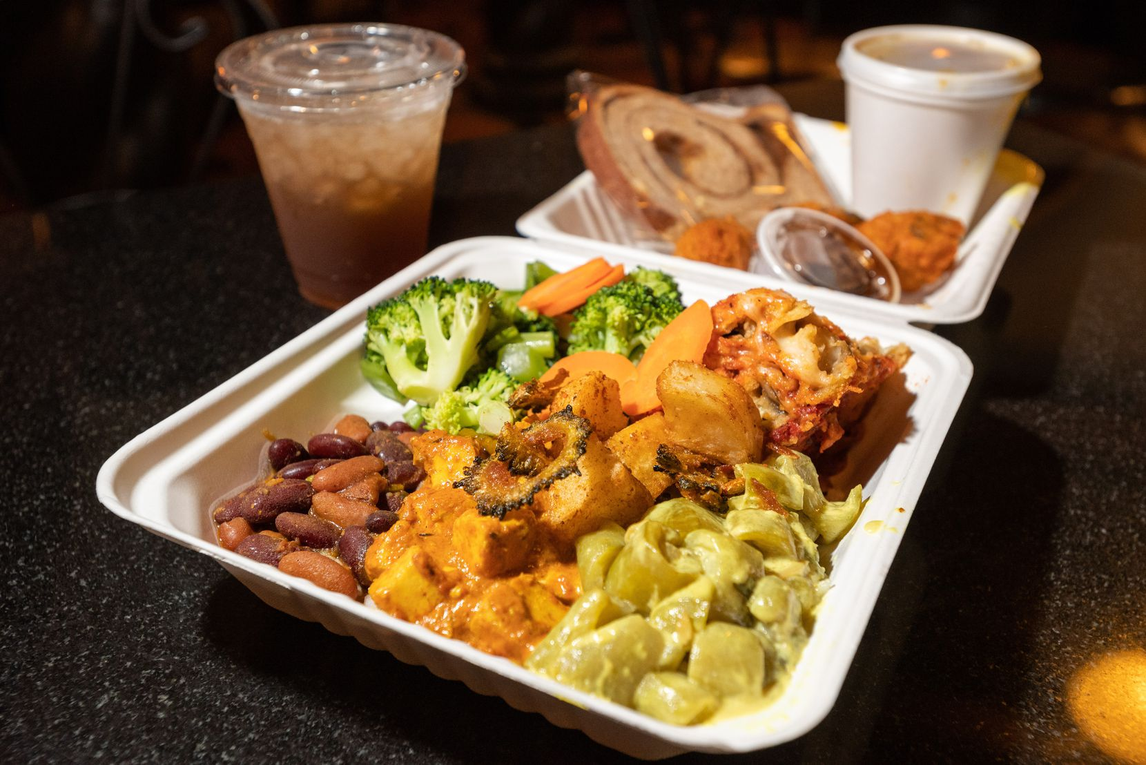 A food order of a variety vegetarian and vegan foods from Kalachandji's vegetarian restaurant on Gurley Avenue in east Dallas, on Saturday, Aug. 28, 2021. Kalachandji's is one of Dallas' last buffets.
