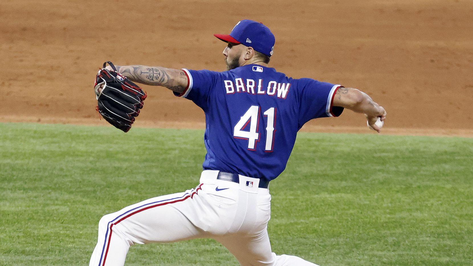 Texas Rangers minor league relief pitcher Joe Barlow throws against the Kansas City Royals in an alternate-site game for minor leaguers at Globe Life Field in Arlington, Friday, April 23, 2021.