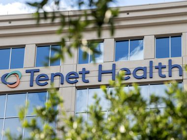 The building housing Tenet Healthcare's headquarters stands next to the Dallas North Tollway.