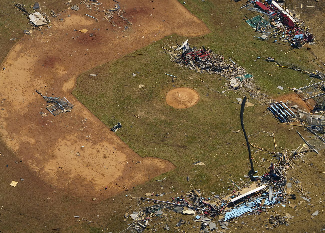 Debris from tornado damage is strewn across a baseball field at Thomas Jefferson High School in an aerial view on Monday, Oct. 21, 2019, in Dallas. (Smiley N. Pool/The Dallas Morning News)
