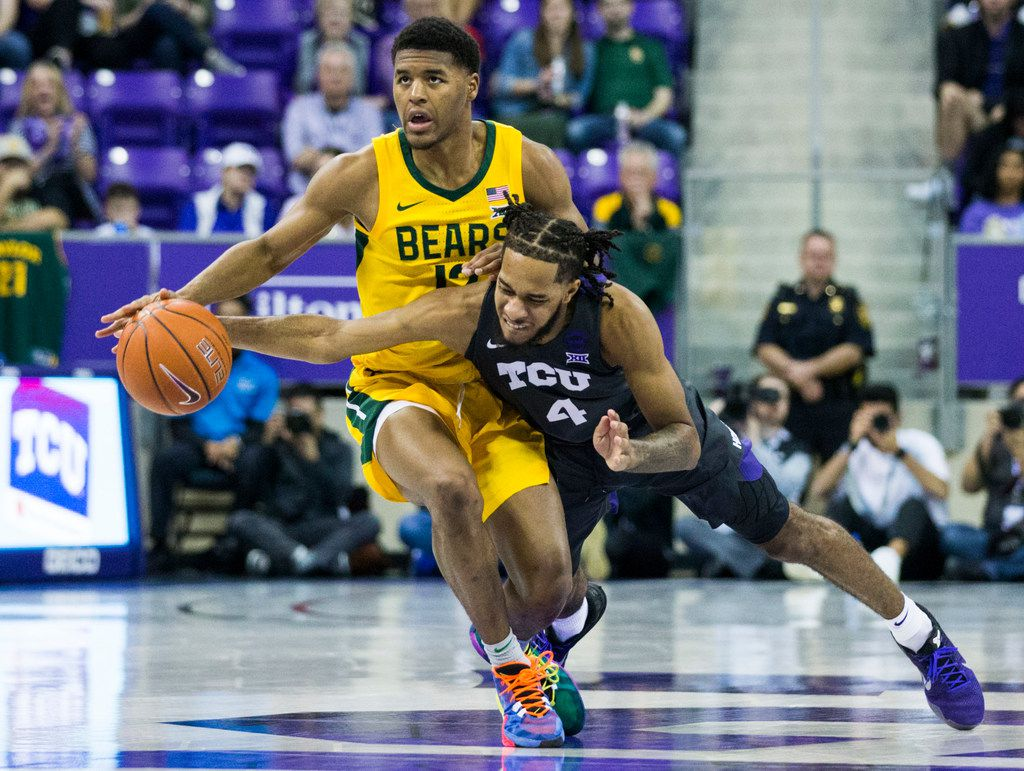 TCU Horned Frogs guard PJ Fuller (4) tries to take control of a loose ball from Baylor Bears guard Jared Butler (12) during the second half of an NCAA mens basketball game between Baylor and TCU on Saturday, February 29, 2020 at Ed & Rae Schollmaier Arena on the TCU campus in Fort Worth. (Ashley Landis/The Dallas Morning News)