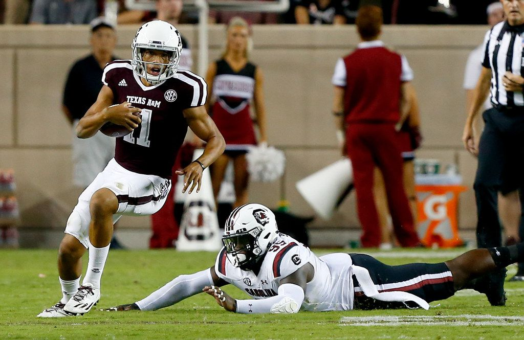 COLLEGE STATION, TX - SEPTEMBER 30:  Kellen Mond #11 of the Texas A&M Aggies avoids the tackle attempt of Dante Sawyer #95 of the South Carolina Gamecocks in the third quarter at Kyle Field on September 30, 2017 in College Station, Texas.  (Photo by Bob Levey/Getty Images)
