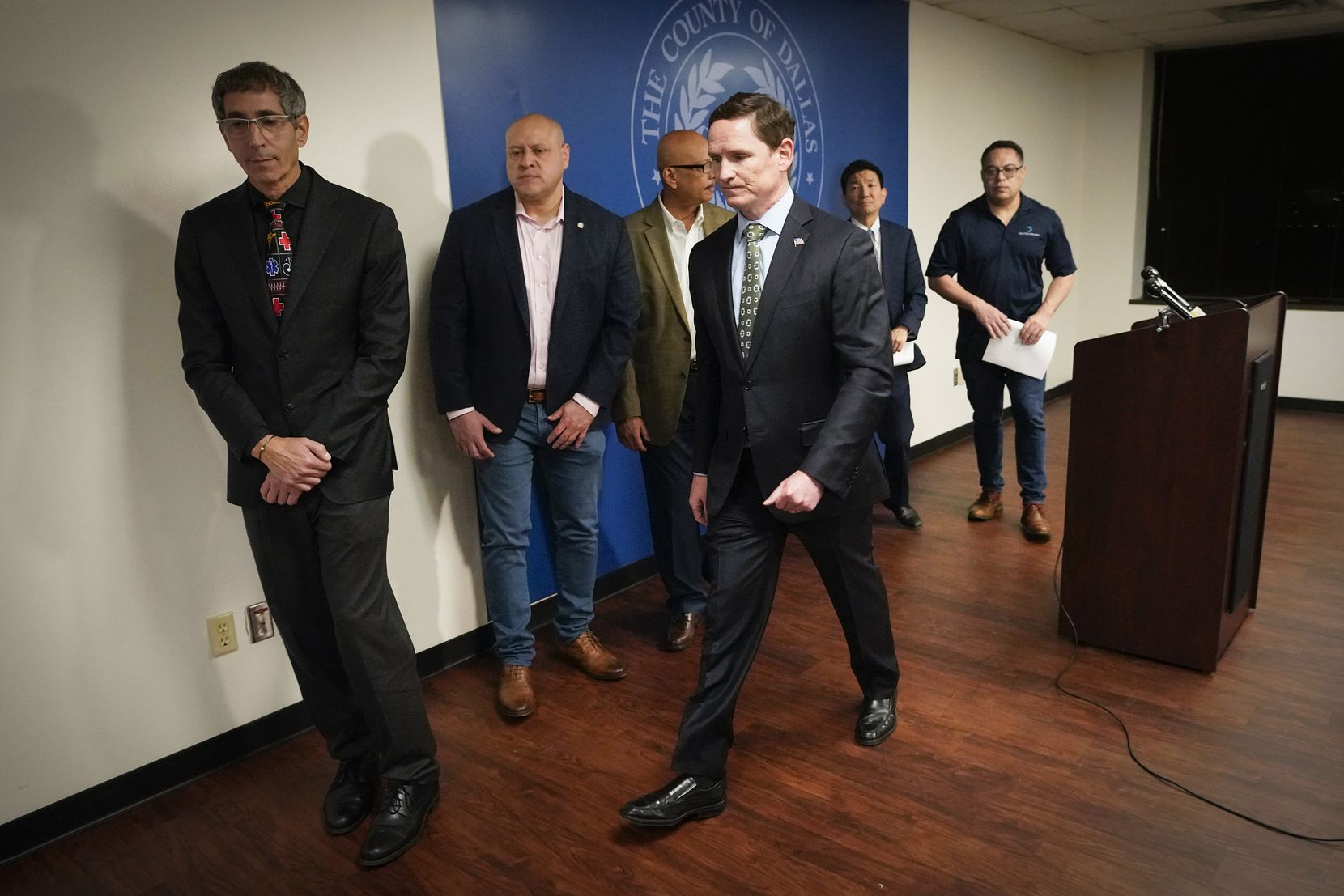Dallas County Judge Clay Jenkins (center) departed a news conference with other city and county officials after announcing a state of disaster as the coronavirus began to spread in Dallas in early March.