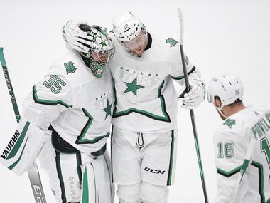Dallas Stars goaltender Anton Khudobin (35) is congratulated by forwards Radek Faksa (12) and Joe Pavelski (16) after a shootout in an NHL hockey game against the Detroit Red Wings in Dallas, Monday, April 19, 2021. Dallas won 3-2 in a shootout. (Brandon Wade/Special Contributor)