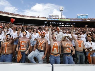 Texas Longhorns fans cheer for their team during the second half of play at the Cotton Bowl in Dallas on Oct. 6, 2018. (Vernon Bryant/The Dallas Morning News)