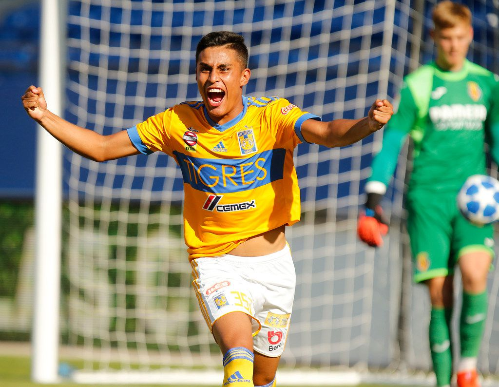 Tigres Fernando Gonzalez (352) celebrates the winning goal against Villarreal goalie Filip Jornensen (13) during a shootout following double ovetime as Tigres UANL played Villarreal CF in the boys U19 Gordon Jago Super Group Final match of the 2019 Dr. Pepper Dallas Cup at Toyota Stadium in Frisco on Sunday, April 21, 2019.  (Stewart F. House/Special Contributor)