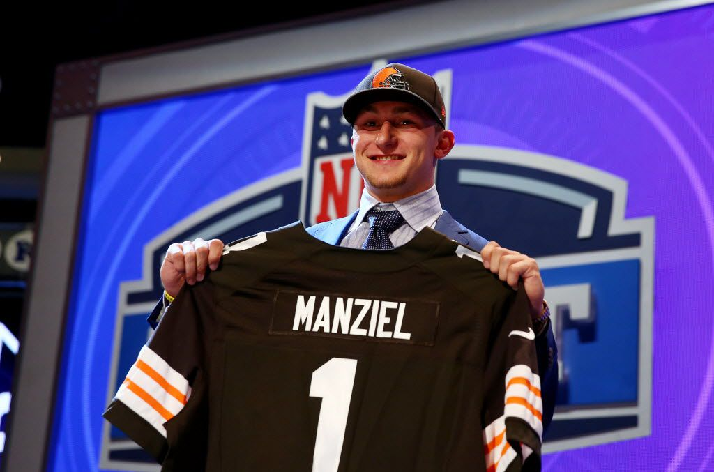 NEW YORK, NY - MAY 08:  Johnny Manziel of the Texas A&M Aggies poses with a jersey after he was picked #22 overall by the Cleveland Browns during the first round of the 2014 NFL Draft at Radio City Music Hall on May 8, 2014 in New York City.  (Photo by Elsa/Getty Images) 05092014xSPORTS