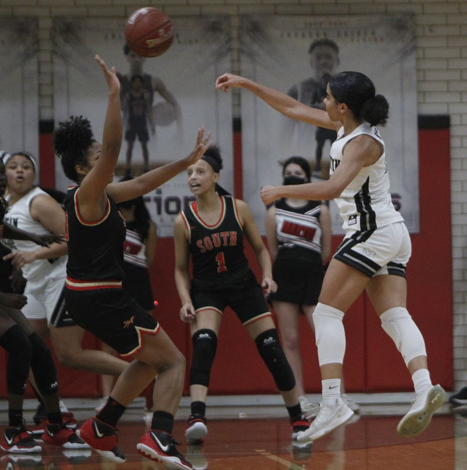 Arlington Martin's Autumn Smith (12) gets off a jump pass to clear the defense of South Grand Prairie's Vasana Kearney (0) during second half action. The two teams played their District 8-6A  girls varsity basketball game at Arlington Martin High School in Arlington on January 26, 2021. (Steve Hamm/ Special Contributor)