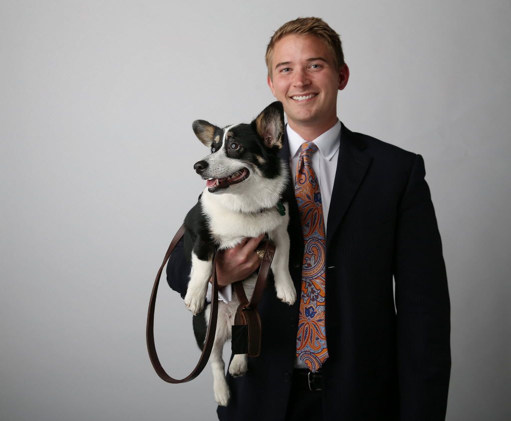 Criminal defense attorney Bryan Wilson, practicing in Fort Worth, stands for a portrait with his dog, Muffins, a tri-color corgi, in The Dallas Morning News photography studio November 3, 2015.