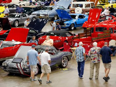 Car and truck enthusiasts walk the auction floor during the Mecum  Auto Auction show and sale at the Kay Bailey Hutchison Convention Center in Dallas.