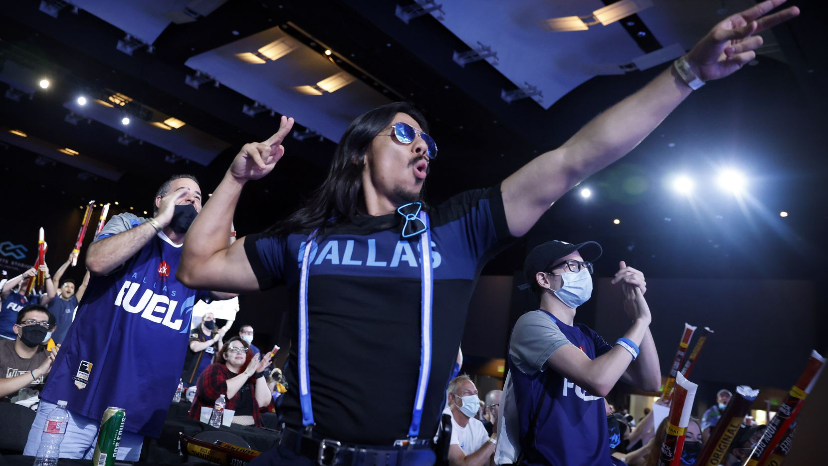 Dallas Fuel fans cheer player Sp9rk1e at the completion of his live winning interview. The Fuel defeated the Houston Outlaws in their Overwatch League match at Esports Stadium Arlington Friday, July 9, 2021. They won The Battle for Texas, 3-0. It was the first in-person live competition for fans in over a year. Houston competed from their hometown.