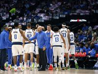 Dallas Mavericks head coach Jason Kidd slaps Sterling Brown's hand during the first half of a preseason game at the American Airlines Center in Dallas, Wednesday, October 6, 2021.