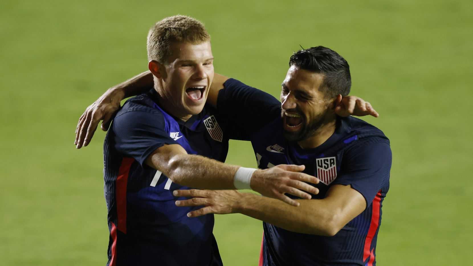 FORT LAUDERDALE, FLORIDA - DECEMBER 09: Chris Mueller #11 of the United States celebrates with Sebastian Lletget #17 after scoring a goal in the 25' against El Salvador during the first half at Inter Miami CF Stadium on December 09, 2020 in Fort Lauderdale, Florida.