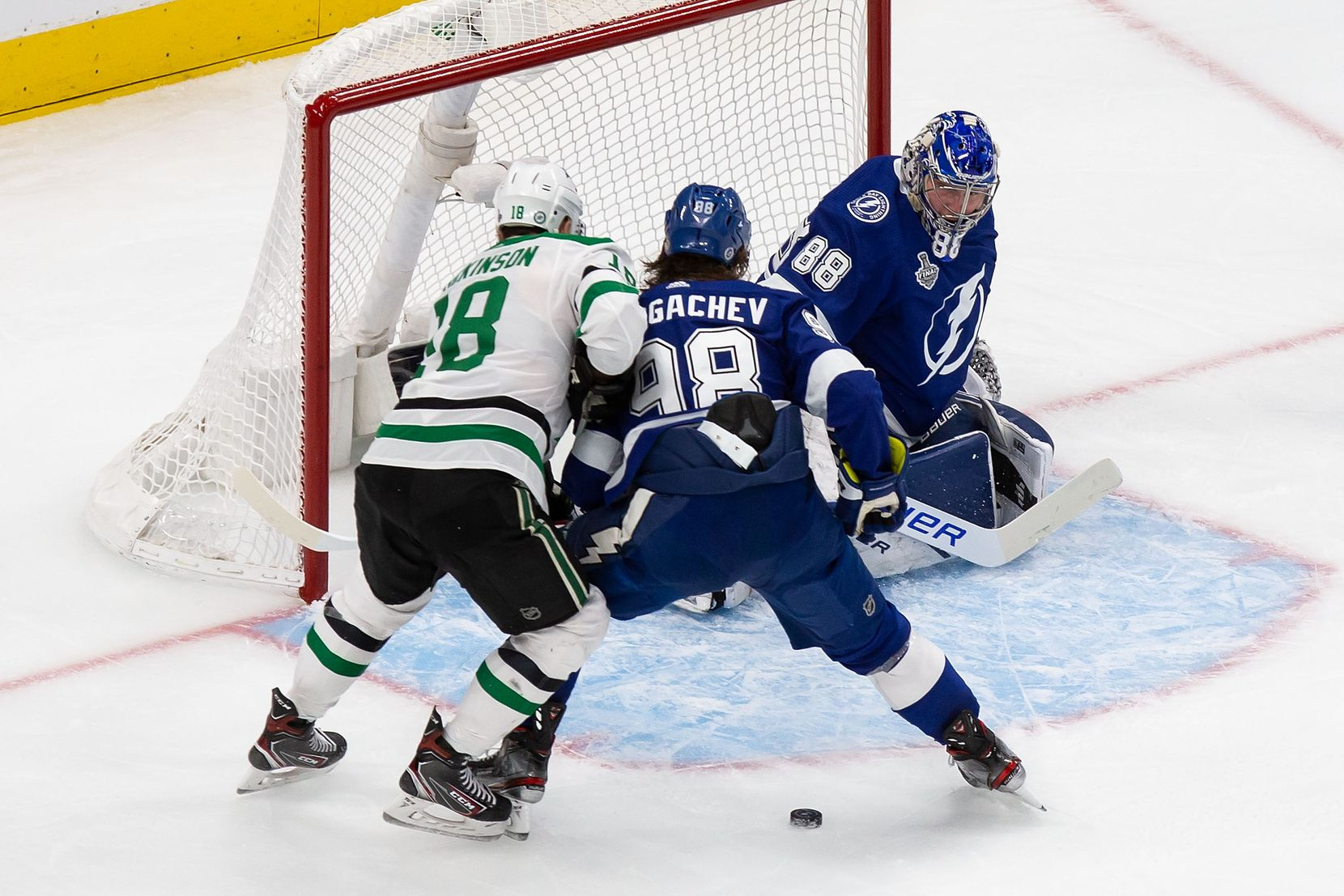 Jason Dickinson (18) of the Dallas Stars battles against Mikhail Sergachev (98) and goaltender Andrei Vasilevskiy (88) of the Tampa Bay Lightning during Game Two of the Stanley Cup Final at Rogers Place in Edmonton, Alberta, Canada on Monday, September 21, 2020. (Codie McLachlan/Special Contributor)