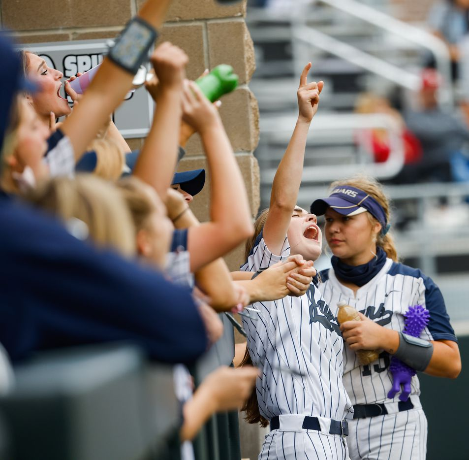 Flower Mound players cheer on McKenna Andrews (6) during the sixth inning of a Class 6A bi-district playoff game against McKinney Boyd on Friday, April 30, 2021, in Denton. (Juan Figueroa/The Dallas Morning News)