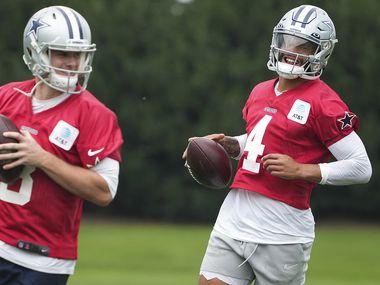 Dallas Cowboys quarterbacks Dak Prescott (4) and Garrett Gilbert (3) participate in a drill during a minicamp practice at The Star on Wednesday, June 9, 2021, in Frisco.