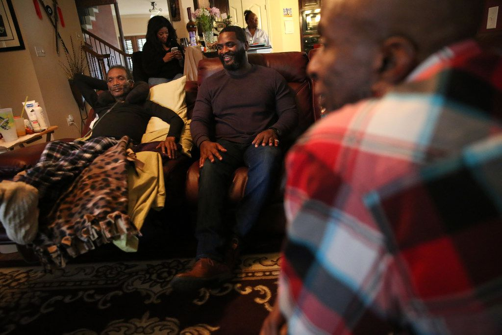 Johnnie Lindsey (far left), a Texas exoneree who spent 26 years in prison for a crime he didn't commit, visited Saturday with fellow exonerees Christopher Scott (middle) and Thomas McGowan (foreground, right) at Lindsey's home in Dallas.