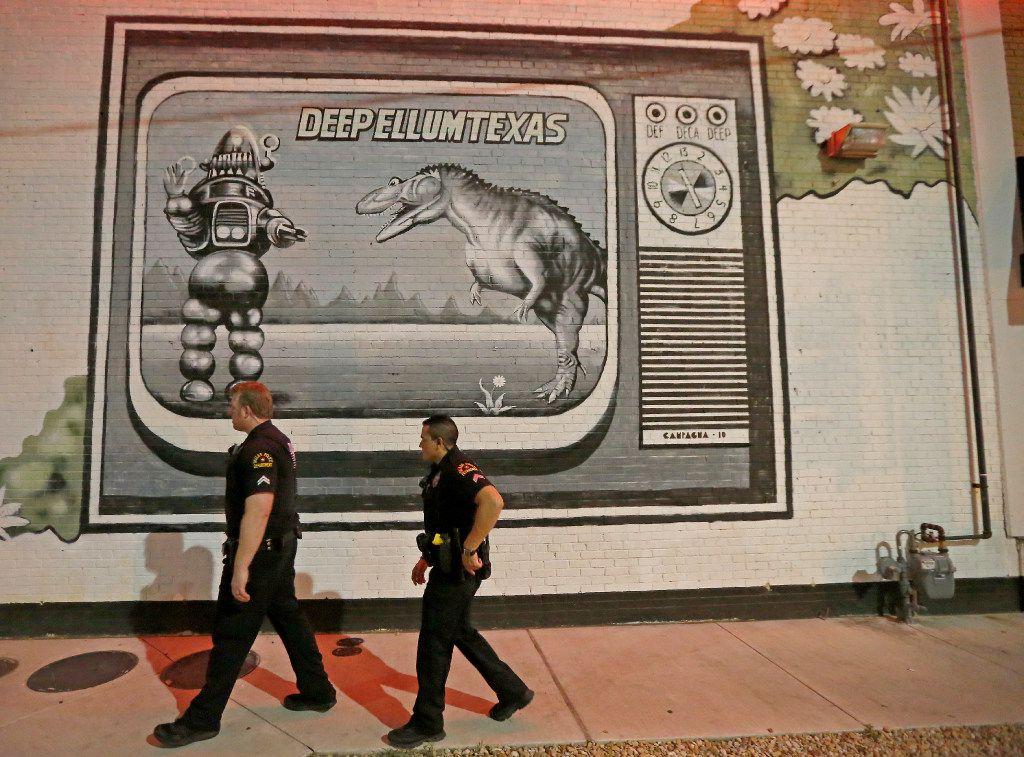 Officers Whitt Melton (left) and Steven Castillo patrol Deep Ellum early Saturday.