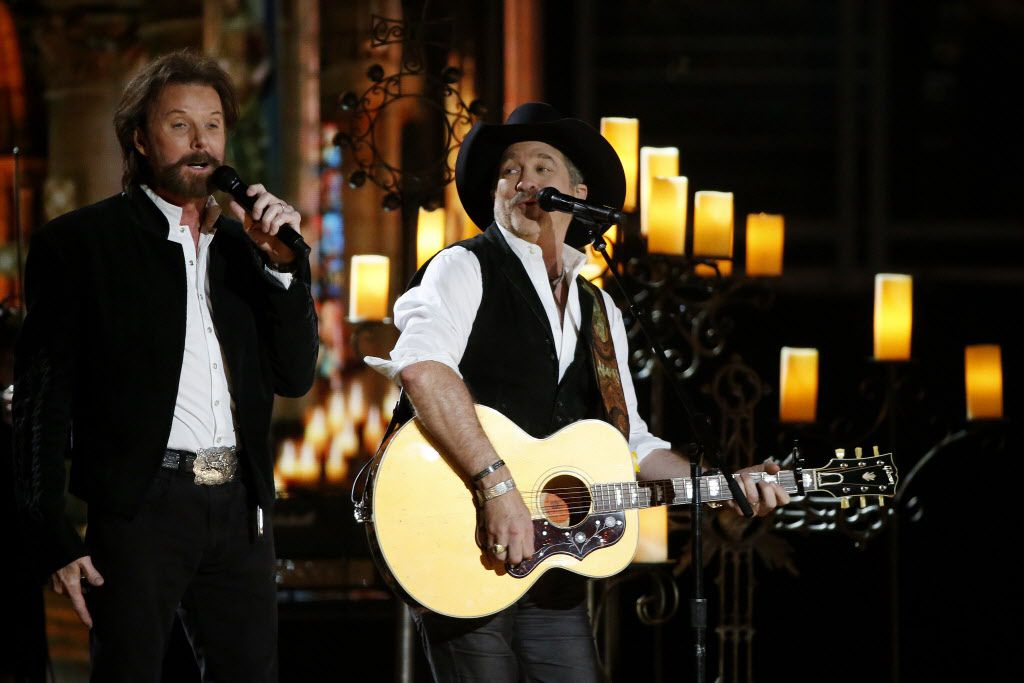 Brooks & Dunn perform during the 2015 Academy of Country Music Awards Sunday, April 19, 2015 at AT&T Stadium in Arlington, Texas.