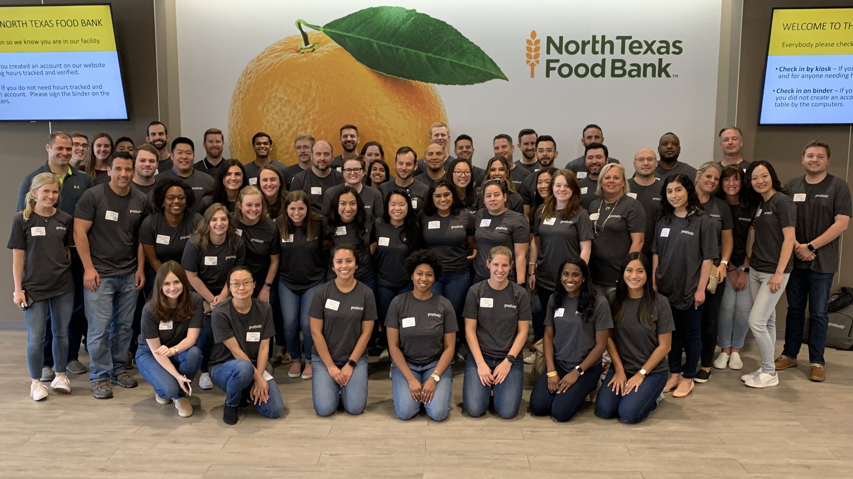 Protiviti workers pause for a photo at one of the company's i on hunger meal-packing events to support the North Texas Food Bank.