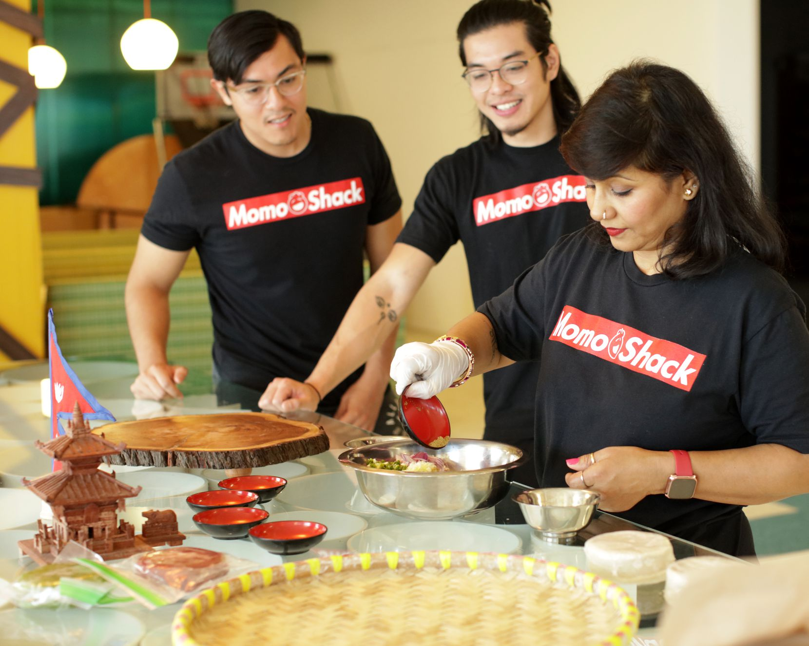 Daniel Flores (left) Thang Duong and Minu Amatya teach a momo making class.