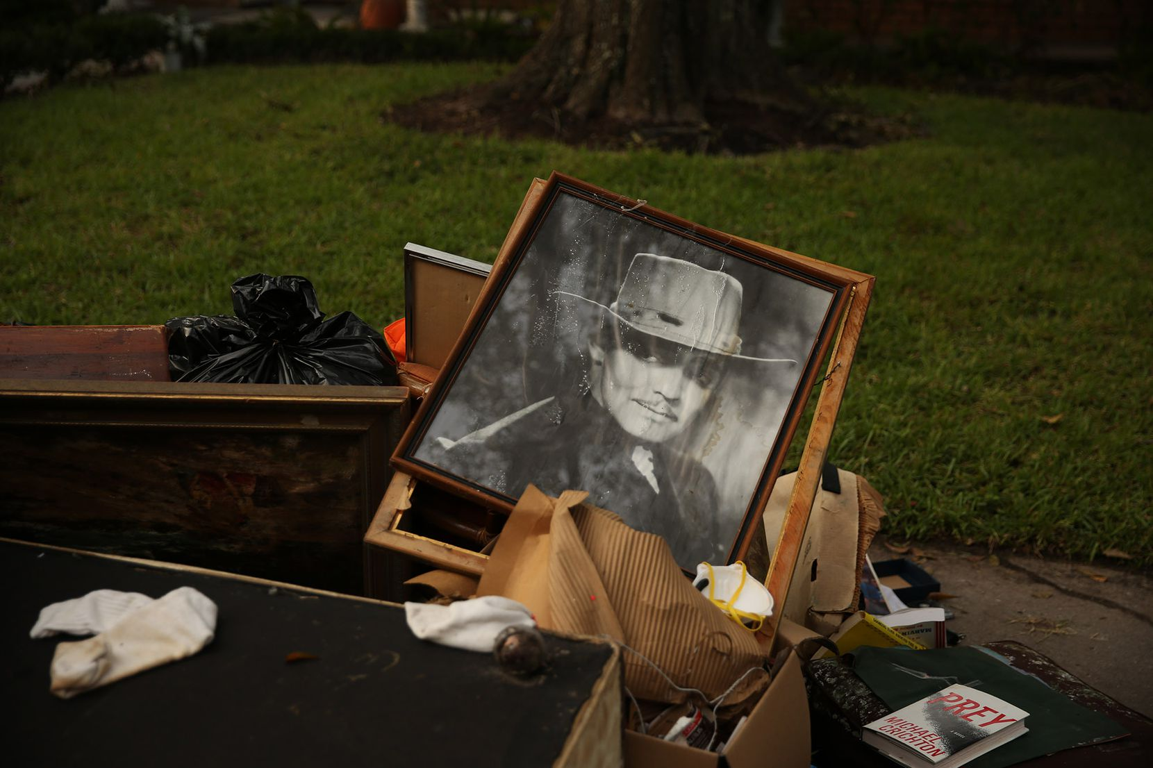 Residents had to trash framed photos of actors and reprints of famous paintings. One family trashed encyclopedias from the 1960s.