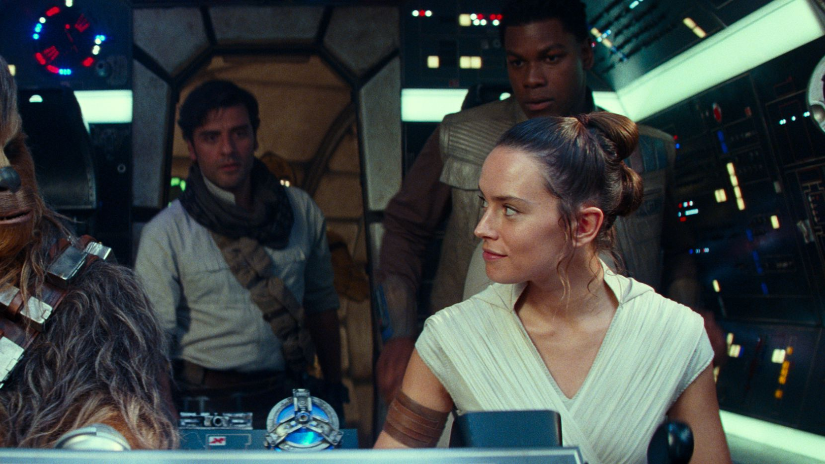 """The Star Wars series began in 1977 and continues into the 21st century with this scene from """"Star Wars"""" The Rise of Skywalker"""", starring (from left) Joonas Suotamo as Chewbacca, Oscar Isaac as Poe Dameron, Daisy Ridley as Rey and John Boyega as Finn."""
