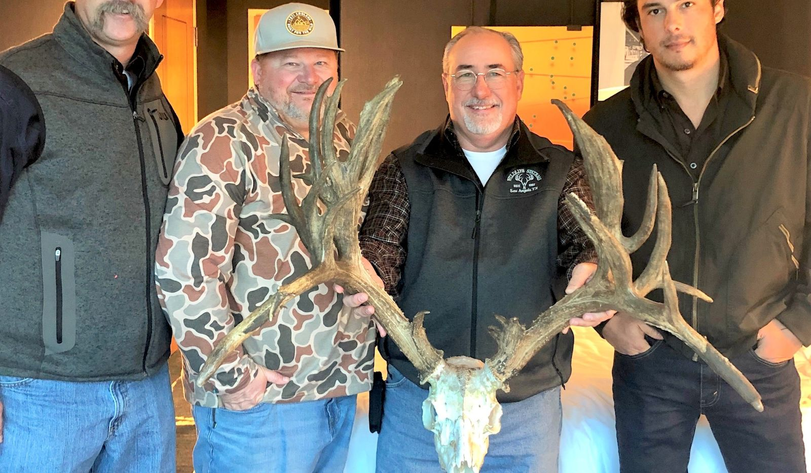 Greg Simons' buck was scored by a three-man panel of certified Boone and Crockett scorers at the Omni Hotel in downtown Dallas. Among the scorers were (left to right) Alan Cain, David Brimager and Craig Bowen (far right).