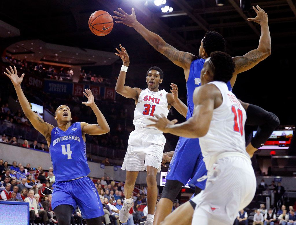 Southern Methodist Mustangs guard Jimmy Whitt (31) passes the ball off to guard Jarrey Foster (10) in the first half against the New Orleans Privateers at Moody Coliseum on the SMU campus in University Park, Texas, Wednesday, December 14, 2017. (Tom Fox/The Dallas Morning News)