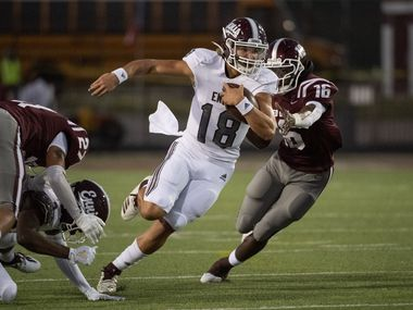 Ennis senior quarterback Collin Drake (18) turns upfield past Red Oak senior Devin Steen (16) during the first half of a high school football game on Friday, September 25, 2020 at Billy Goodloe Stadium in Red Oak, Texas.