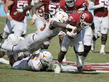 Texas linebacker Joseph Ossai (46) forces a fumble by Oklahoma running back T.J. Pledger (5) during an NCAA college football game in Dallas, Saturday, Oct. 10, 2020.