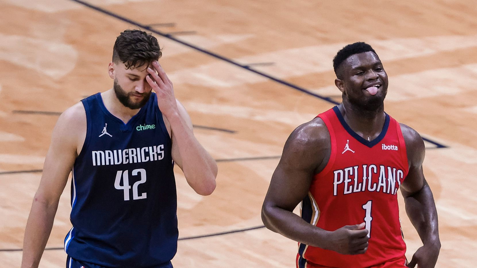 New Orleans Pelicans forward Zion Williamson (1) and Dallas Mavericks forward Maxi Kleber (42) react following a basket in the second quarter of an NBA basketball game in New Orleans, Saturday, March 27, 2021. (AP Photo/Derick Hingle)