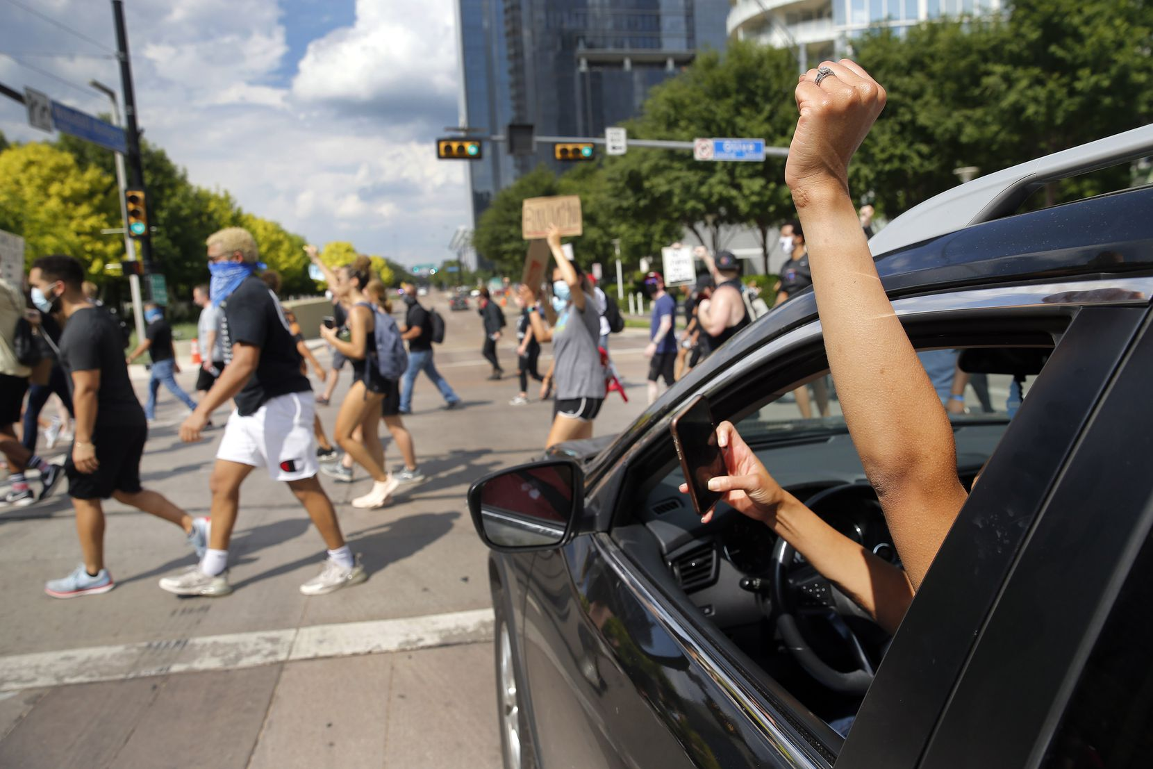 A supporter raises her first as protestors supporting Black Lives Matters march through Klyde Warren Park in downtown Dallas, Tuesday, June 2, 2020. They gathered to protest the in-custody death of George Floyd.