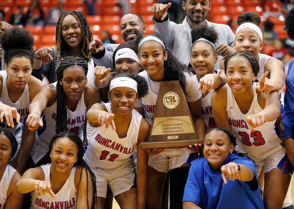 The Duncanville girls basketball team poses for photos with the Class 6A Region I championship trophy after defeating Cedar Hill at Wilkerson-Greines Activity Center in Fort Worth, Saturday, February 29, 2020. Duncanville won the title game, 56-54. (Tom Fox/The Dallas Morning News)