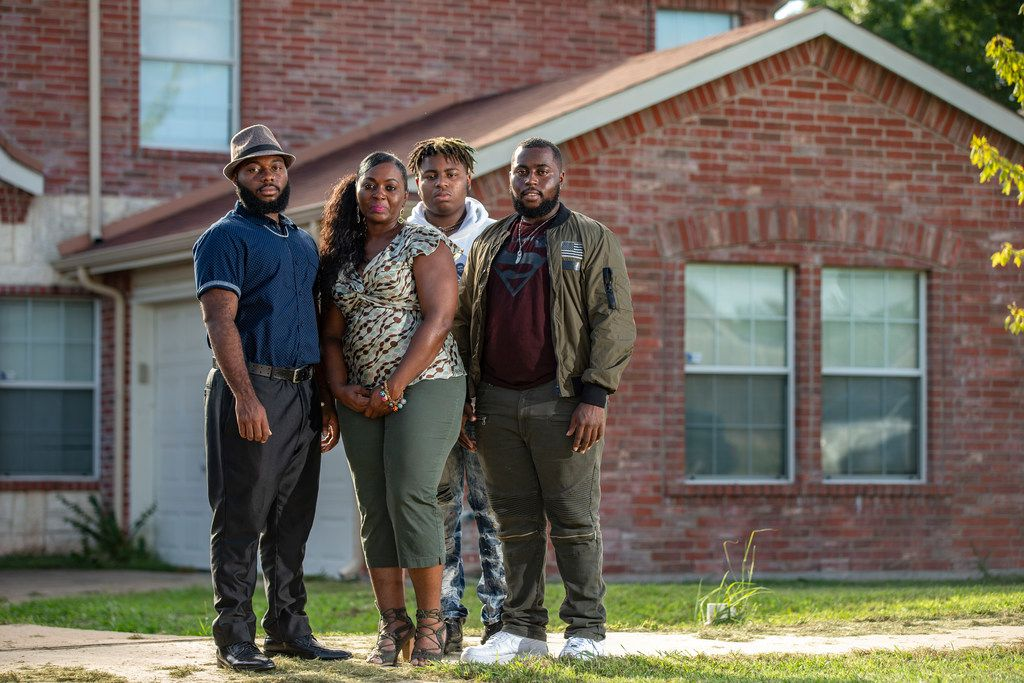 Sammie Anderson, second from left, poses with her sons (from left to right) Samuel Bible, 18, Tyrone Anderson, 15, and Grant Bible at their home in DeSoto, Monday, September 17, 2018.
