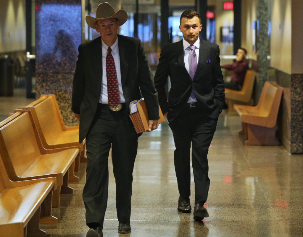 Johnny Manziel (right) walks in to the Frank Crowley Courts Building with his attorney Jim Darnell. The pair attended a hearing on Tuesday about Manziel's misdemeanor assault charge that is set to be dismissed if he follows a set of rules. (Andy Jacobsohn/The Dallas Morning News)