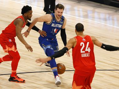 Team LeBron's Luka Doncic (2) dribbles past Team Giannis's Donovan Mitchell (24) towards Rudy Gobert (24) during the first half of play in the NBA All-Star 2020 game at United Center in Chicago on Sunday, February 16, 2020. (Vernon Bryant/The Dallas Morning News)