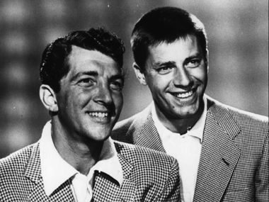 In this Aug. 27, 1954, file photo, Dean Martin, left, and Jerry Lewis pose for the Colgate Comedy Hour. Lewis, the comedian and director whose fundraising telethons became as famous as his hit movies, died Sunday, Aug. 20, 2017, in Las Vegas, according to his publicist. He was 91.  (AP Photo/File)