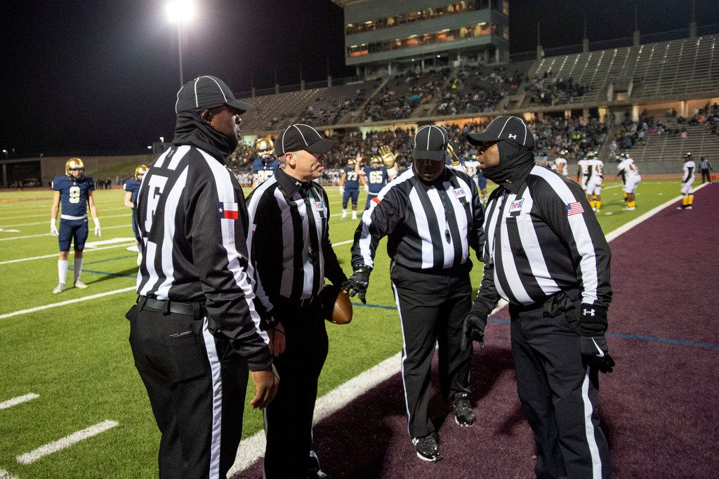 Referees confer after a controversial play in the end zone on which a Jesuit touchdown reception was overturned and called incomplete in the first half of an area round high school football playoff game between Jesuit and Longview on Friday, November 22, 2019 at John Kincaide Stadium Dallas. (Jeffrey McWhorter/Special Contributor)