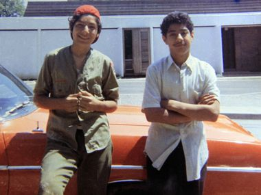 A photo of David Rodriguez, 13, (left) and his brother Santos, 12,  as they stood by a relative's car in 1973 was taken a  month before Santos was killed.