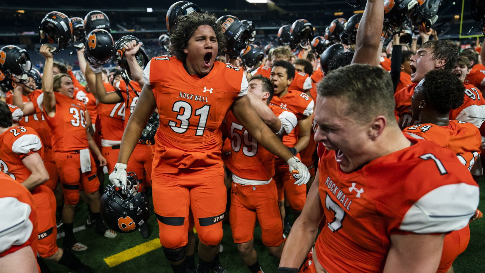 Rockwall celebrates a 60-59 win over Allen in a Class 6A Division I area-round high school football playoff game between Allen and Rockwall on Friday, November 22, 2019 at AT&T Stadium in Arlington.
