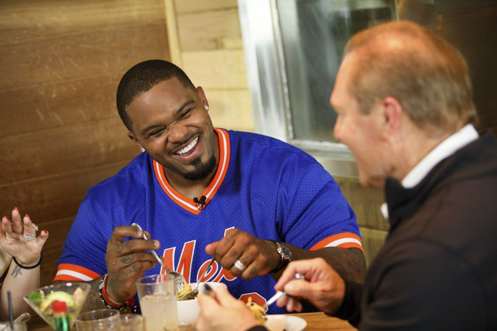 """Prince Fielder laughs while eating a bowl of Uni Pasta during filming of his show """"Fielder's Choice"""" at EMC Seafood and Raw Bar on Monday, June 19, 2017 in Los Angeles, Calif. In July, 2016, professional MLB baseball player Prince Fielder got an unexpected and shocking diagnosis - he had suffered a second herniation of a disc and that his baseball career was over. He is now working on a food and cooking show """"Fielders Choice"""" and pursuing an acting career in his retirement from the Texas Rangers team. (Photo by Patrick T. Fallon/Special Contributor to The Dallas Morning News)"""