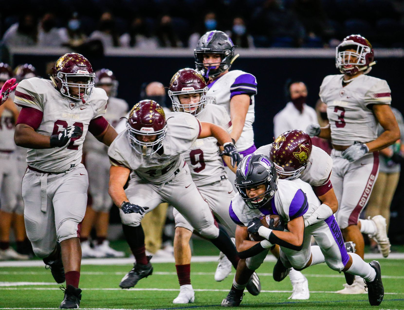Frisco Independence Jordyn Tyson (4) is tackled by the Frisco Heritage's defense during the second half of a game at the Ford Center at the Star in Frisco on Thursday, Dec. 3, 2020. (Juan Figueroa/ The Dallas Morning News)