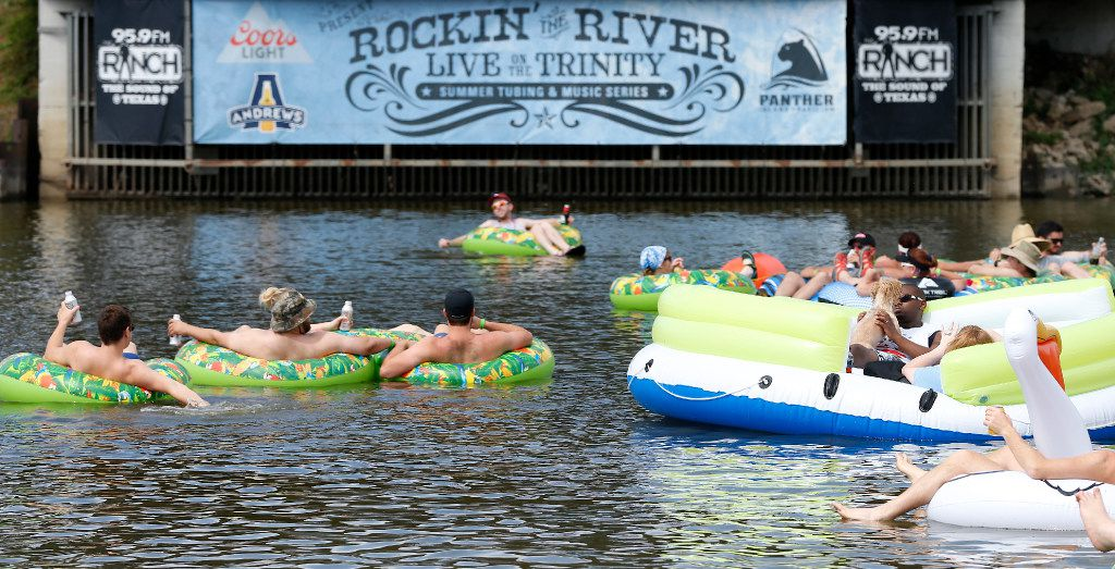 People in tubes float on the Trinity River while listening to the live music during the Rockin' the River event at Panther Island Pavilion in Fort Worth, Texas, Saturday, July 1, 2017. (Jae S. Lee/The Dallas Morning News)