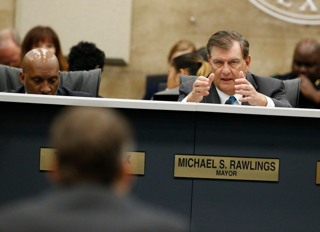 Mayor Mike Rawlings asks questions to Atmos Energy representatives about gas lines at Dallas City Hall in Dallas on April 18, 2018.  (Nathan Hunsinger/The Dallas Morning News)