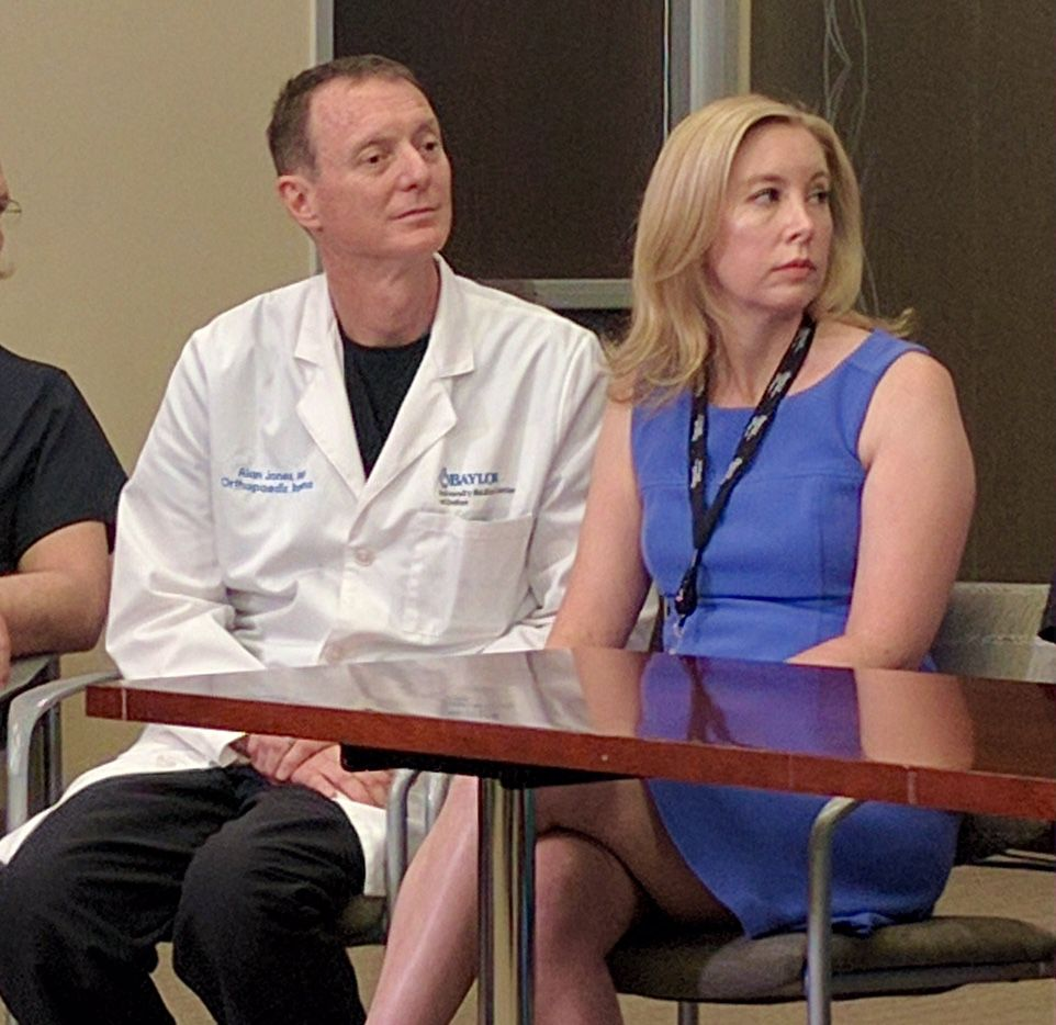 Dr. Alan Jones is medical director of orthopedic surgery at Baylor University Medical Center. His wife, Anne Marie Warren, is a clinical psychologist. The couple attended a news conference Sunday at which shooting survivor Shetamia Taylor thanked all those who helped her.