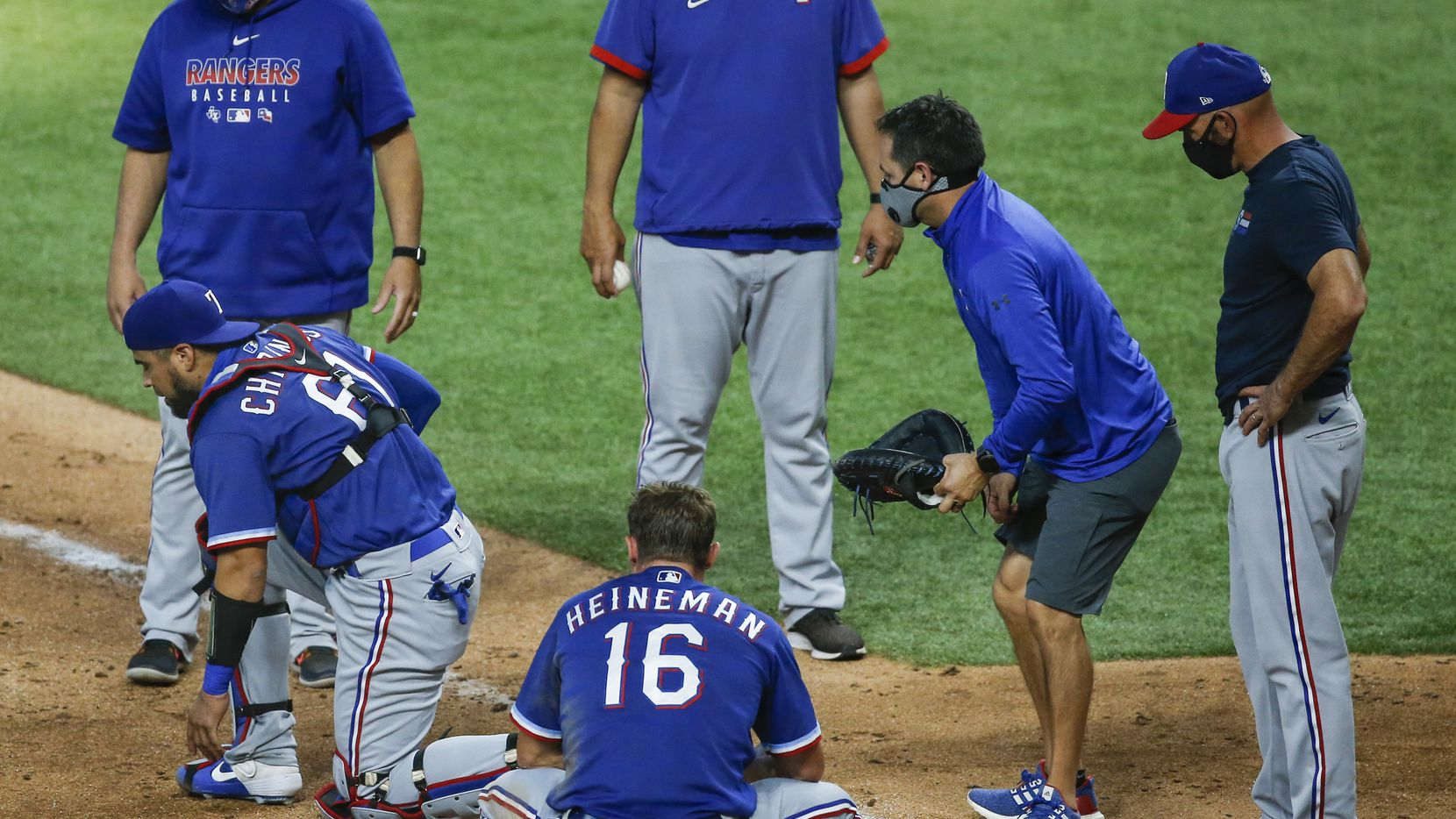 Catcher Robinson Chirinos works to stand up after being injured during a run-in at home plater as the Texas Rangers play an intrasquad game during Summer Camp on Monday, July 13, 2020 at Globe Life Field in Arlington, Texas. (Ryan Michalesko/The Dallas Morning News)
